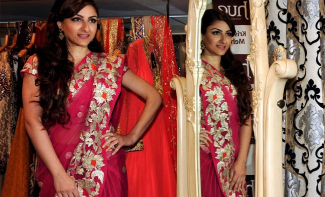 Soha Ali Khan poses for a photo during the launch of the new Hue collection