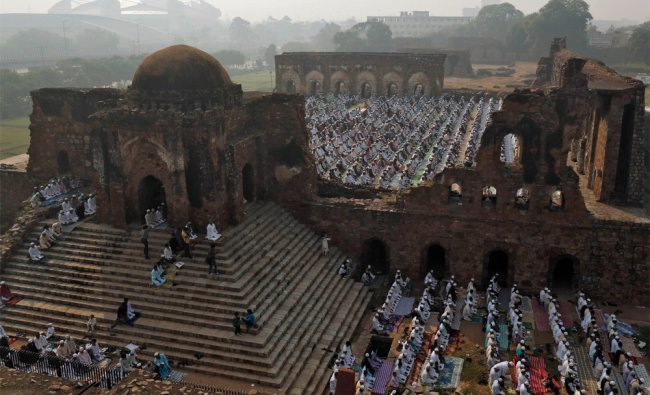 Muslims offer prayers at the ruins of the Feroz Shah Kotla mosque on the occasion of Eid al-Adha