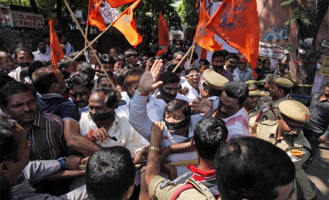 Police detain VHP activists during a protest rally against the slaughter of cows during Eid al-Adha