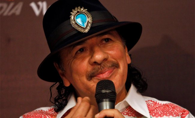 Carlos Santana speaks during a press conference in New Delhi...