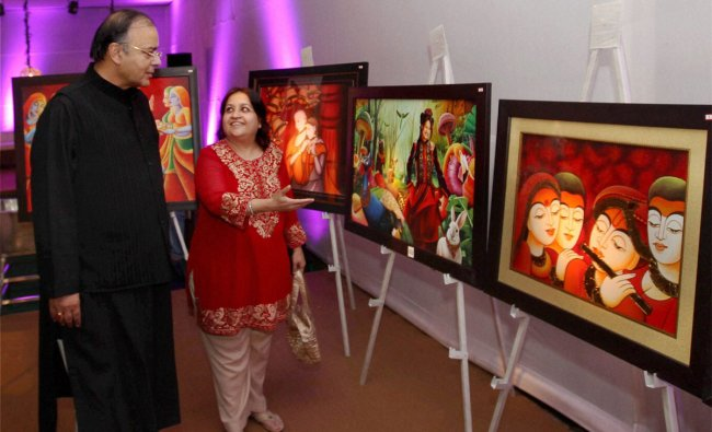 Ritu Kumar shows her pictures to BJP leader Arun Jaitley after the inauguration of her exhibition