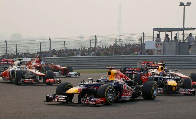 Red Bull Formula One driver Sebastian Vettel of Germany leads the Indian F1 Grand Prix