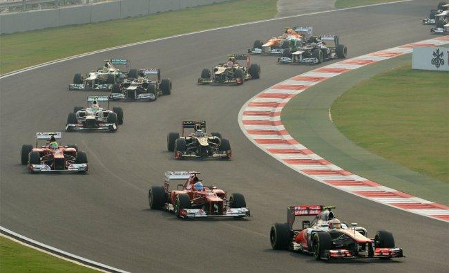 McLaren-Mercedes driver Lewis Hamilton of Britain (R) stays ahead of Ferrari driver Fernando Alonso