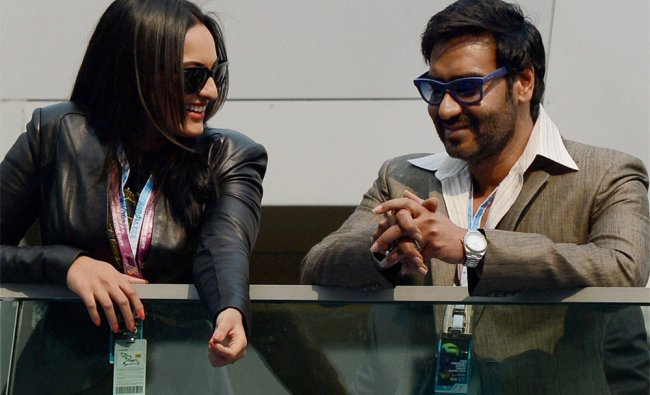 Ajay Devgn with Sonakshi Sinha at the Formula One Indian Grand Prix in Greater Noida...