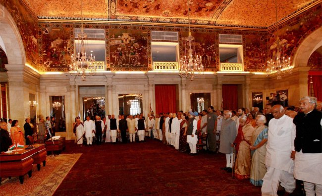 Newly sworn-in ministers stand at national anthem during swearing-in ceremony at Rashtrapati Bhavan