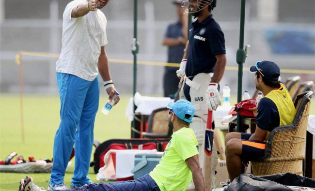 Yuvraj Singh and teammates during a practice session in Mumbai on Monday