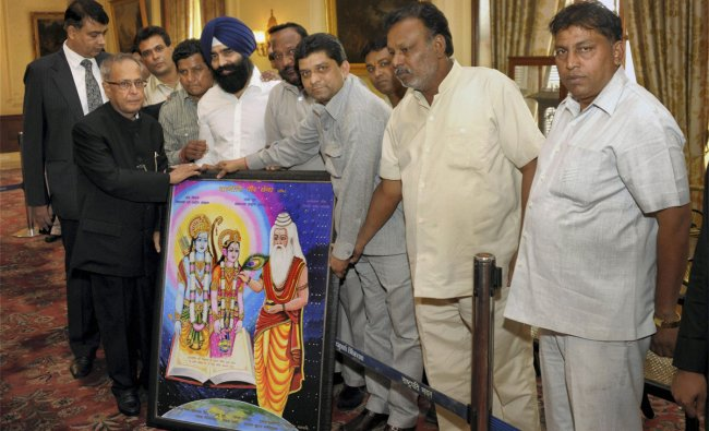 President Pranab Mukherjee at a function to pay homage to cartoonist the late PKS Kutty