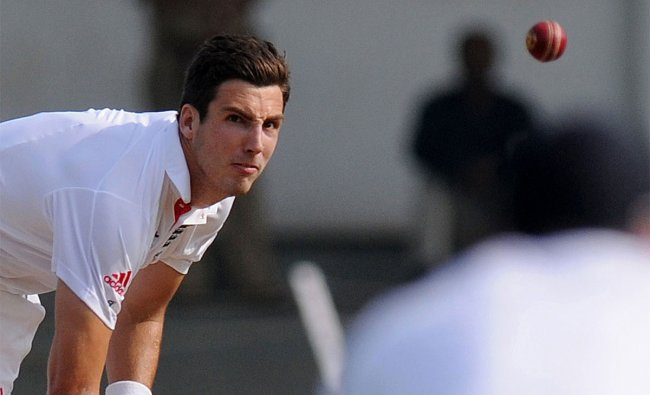 England cricketer Steve Finn bowls during the first day of a three-day practice match