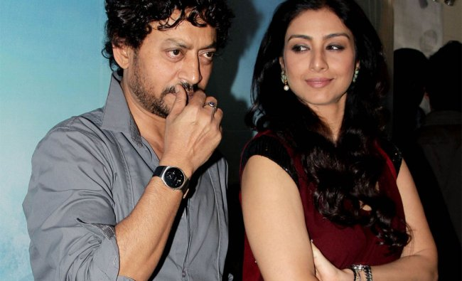 Indian Bollywood actress Tabu (R) and actor Irfan Khan pose during a promotional event