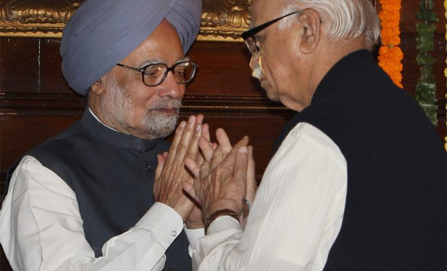 Prime Minister Manmohan Singh exchanges greetings with senior BJP Leader L K Advani