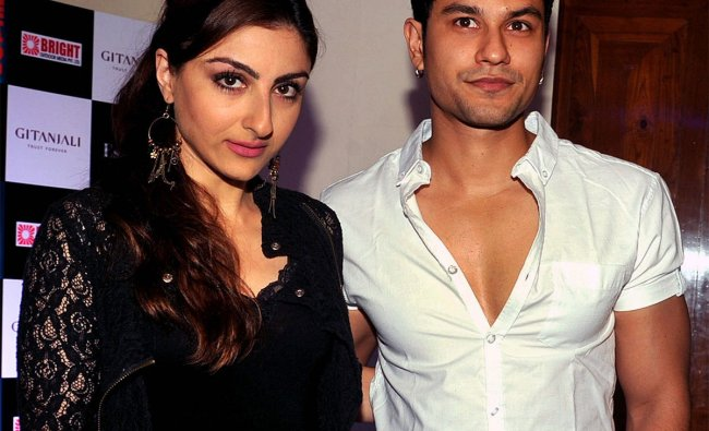 Soha Ali Khan (L) and Kunal Khemu pose during the new video launch of Sophie Choudry