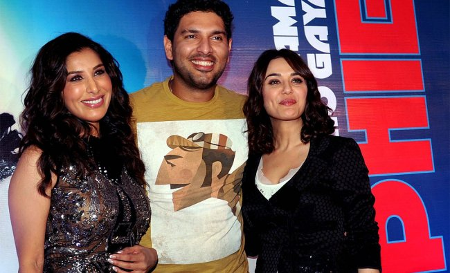 Sophie Choudry (L) poses with film actress Preity Zinta (R) and Indian cricketer Yuraj Singh