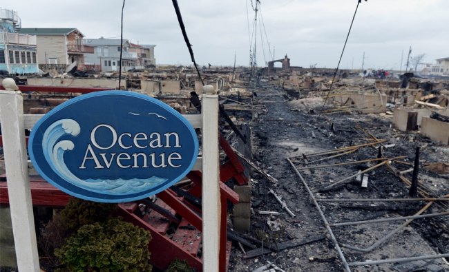 Fire destroyed 80 homes as a result of Hurricane Sandy which hit New York...