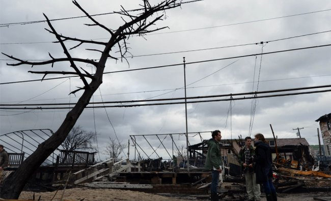 Damage in New York after fire destroyed about 80 homes as a result of Hurricane Sandy ...