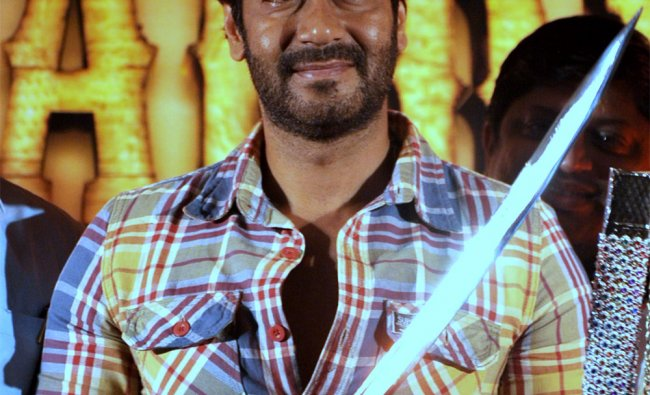 Ajay Devgn poses with a sword during a press event for the forthcoming Hindi film \'Son of Sardaar\'