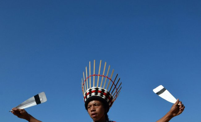 A Zerliang tribesman performs a cultural dance during the Chega Gadi harvest festival at Jaluki