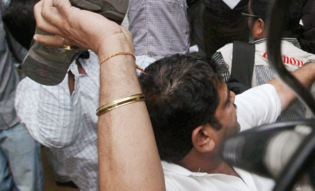 A man throws shoe at Arvind Kejriwal during a press conference