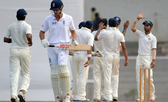 India \'A\' cricketers (background) celebrate after the dismissal of England cricketer Alastair Cook