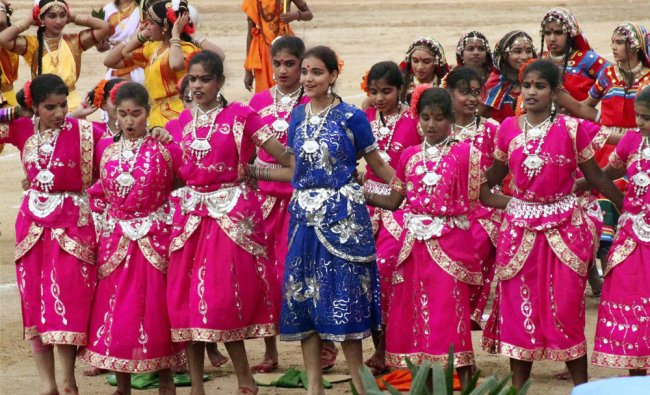 School students perform a cultural programme during Andhra Pradesh Formation Day function in...