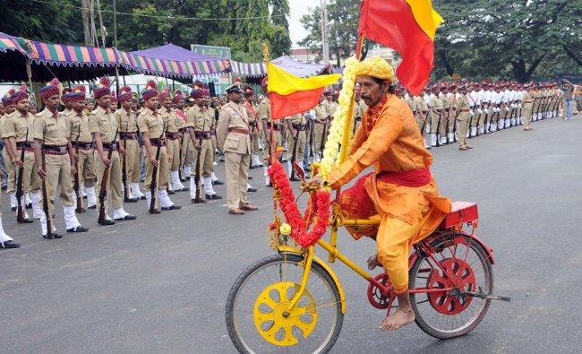 A Kannada fan took part during the celebration of 57th Kannada Rajyotsava procession in Mysore ...