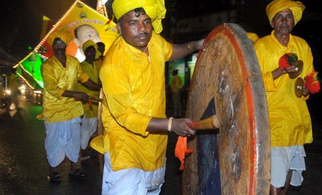 Artists performs traditional dance during the 57th Kannada Rajyotsava celebration at MG Road ...