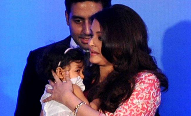 Bollywood actress Aishwarya Rai Bachchan holds her daughter Aradhya as her husband Abhishek...