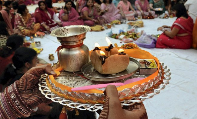 Punjabi women perform prayers during \'Karva-Chauth\' festival in Patna on Friday....