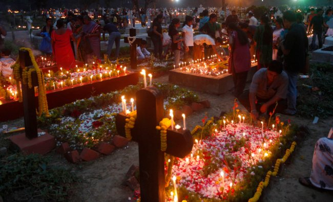 Kolkata Christians attend prayers at the graves of their relatives on All Saints day...