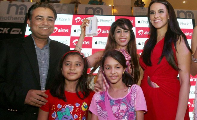 Actress Neha Dhupia with CEO of Airtel for Delhi NCR region Rohit Gothi along with the winners of...