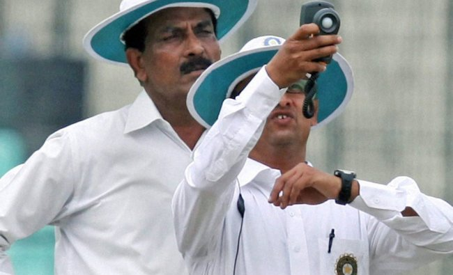 Umpires check the light with a light meter during the Ranji Trophy match between Bengal and...