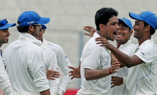 Bengal bowler Laxmi Ratan Shukla being greeted by his teammates after dismissing Rajasthan...