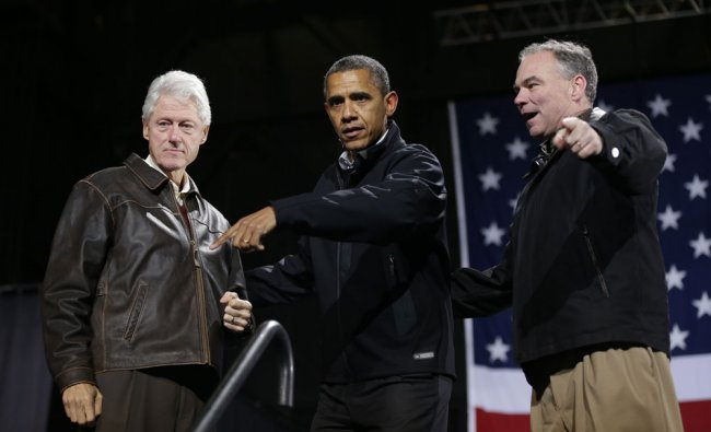 President Barack Obama, center, is joined by former President Bill Clinton, left, and Democratic...