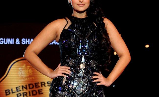 Bollywood actress Sonakshi Sinha displays a creation by designer Falguni and Shane Peacock at the...