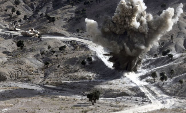 U.S. soldiers blows up a roadside bomb set up by Taliban fighters near the town of Walli Was in...