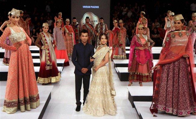 Bollywood actress Malaika Arora Khan displays a creation by designer Vikram Phadnis...