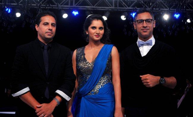 Indian Tennis Player Sania Mirza (C) displays a creation by designer Shantanu and Nikhil...