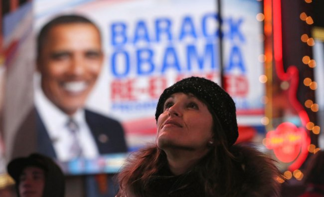 People watch election results in Times Square after television networks called the election in...