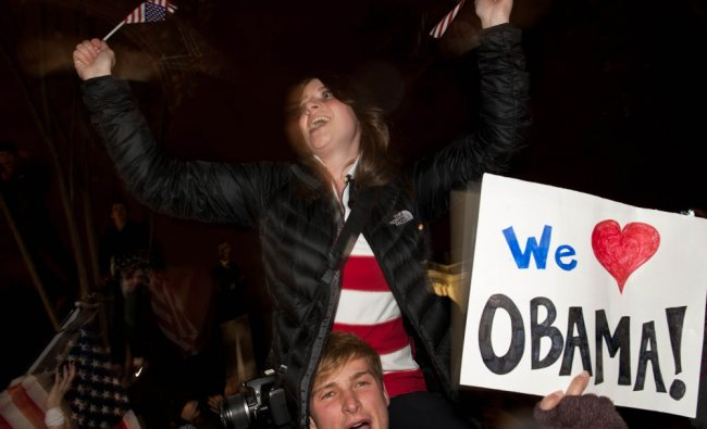 People celebrate in front of the White House in Washington on November 6, 2012. Obama was...