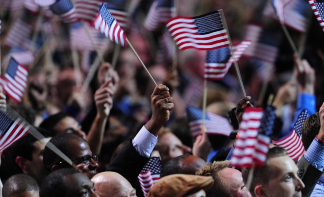 Supporters of US President Barack Obama celebrate as CNN projects victory for Obama on election...