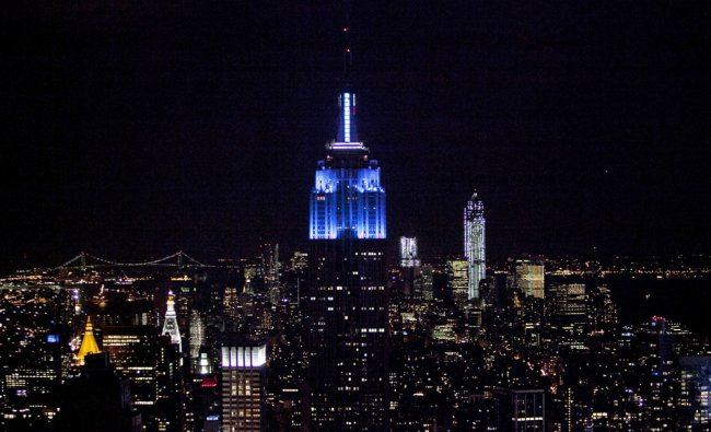 The Empire State Building is lit blue after Obama wins the presidential election on election...