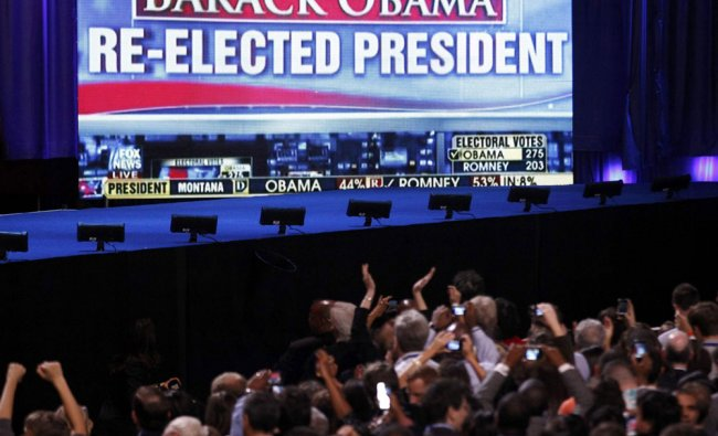 Supporters of U.S. President Barack Obama cheer the news of the president\'s apparent re-election...