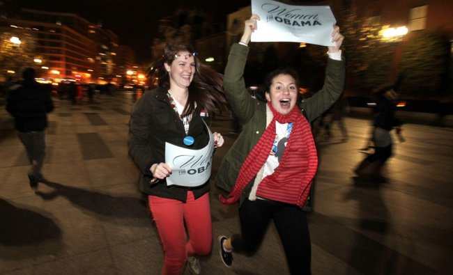 Supporters of U.S. President Barack Obama celebrate the projections of his victory in the 2012...