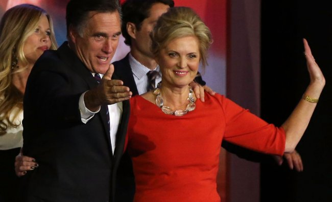 Republican presidential candidate, Mitt Romney, wife, Ann Romney, wave to the crowd on stage...
