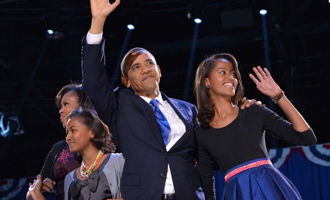 US President Barack Obama accompanied by (from L-R ) First Lady Michelle and daughters Sasha and...