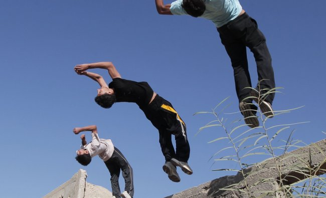 Palestinian youths practicing their parkour skills in the town of Khan Younis