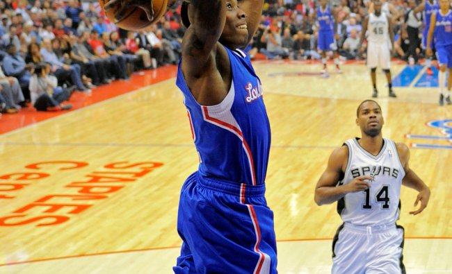 Los Angeles Clippers guard Eric Bledsoe, left, goes up for a dunk against San Antonio Spurs