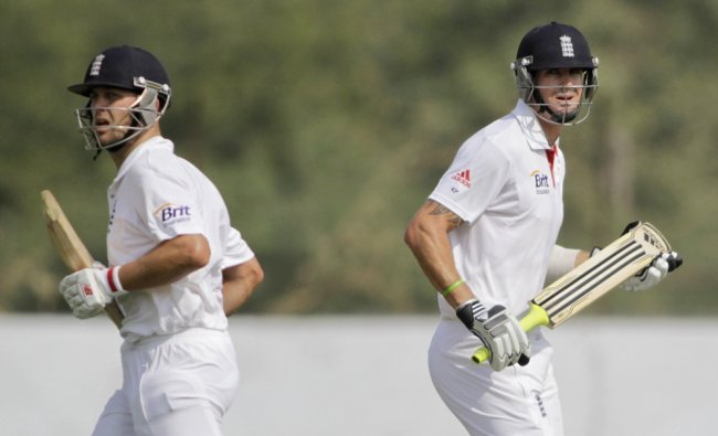 Kevin Pietersen and Jonathan Trott run between the wickets during a practice match