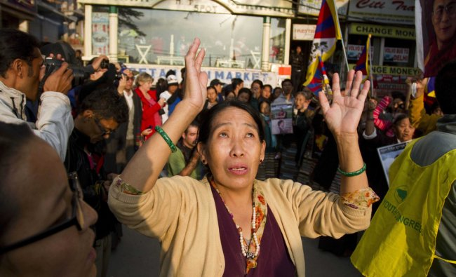 An exiled Tibetan participates in a protest rally in solidarity with Tibetan self-immolators