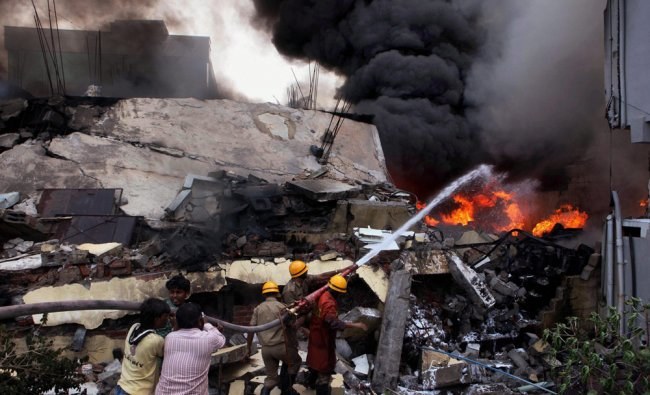 Fire fighters dousing the blaze which erupted in a paint factory in Bangalore