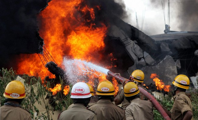 Fire fighters dousing blaze which broke out in a paint factory in Bangalore
